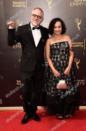 Stock Picture of Don Diers, left, and Denise Pizzini arrive at night one of the Television Academy's 2016 Creative Arts Emmy Awards at the Microsoft Theater on in Los Angeles