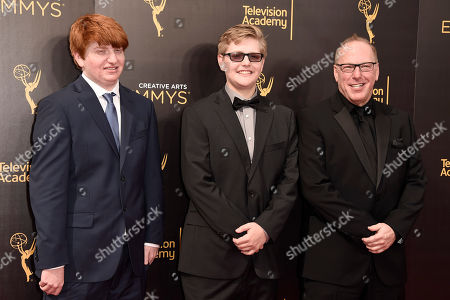 Mark Blutman, from right, Liam Blutman and Luke Blutman arrive at night one of the Creative Arts Emmy Awards at the Microsoft Theater, in Los Angeles