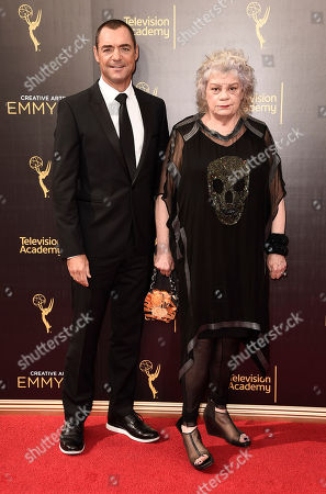 David S. Lee, left, and Moonyeenn Lee arrive at night one of the Television Academy's 2016 Creative Arts Emmy Awards at the Microsoft Theater on in Los Angeles