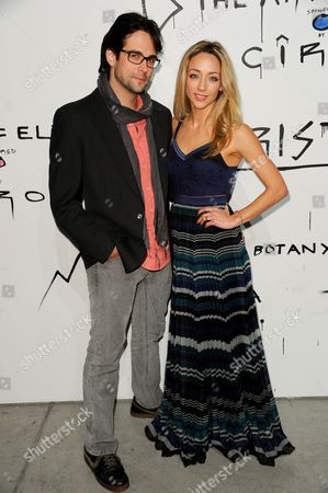 "Stock Photo of Michael Elprin, left, and Sarah Scott arrive at The Art of Elysium's 6th Annual ""Pieces of Heaven"" art auction at the ACE Museum on in Los Angeles"
