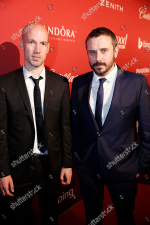 Rick Rowley, left, and Jeremy Scahill arrive at The Hollywood Reporter Nominees Night presented by Cadillac, Bing, Delta, Pandora jewelry, Qua, and Zenith, at Spago, in Beverly Hills, Calif