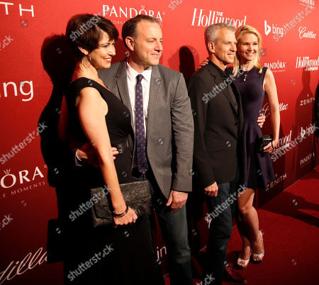 From center left, Kirk DeMicco, Chris Sanders and guests arrive at The Hollywood Reporter Nominees Night presented by Cadillac, Bing, Delta, Pandora jewelry, Qua, and Zenith, at Spago, in Beverly Hills, Calif