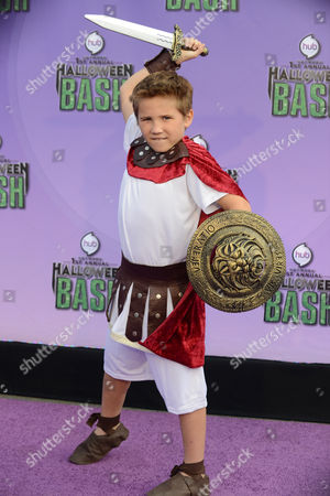 """Stock Image of Tyler Champagne arrives at """"Hub Network's First Annual Halloween Bash"""", at the Barker Hanger in Santa Monica, Calif. The star-studded special will be broadcasted on the Hub Network on Saturday Oct. 26, 2013"""
