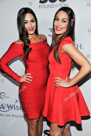 Nicole Garcia-Colace, and Brianna Garcia-Colace arrive at The Wishing Well Winter Gala at the Beverly Wilshire Hotel, on Tuesday, December, 4, 2013 in Beverly Hills, Calif