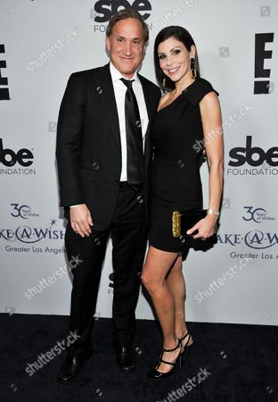 Dr. Terry J. Dubrow, left, and Heather Dubrow arrive at The Wishing Well Winter Gala at the Beverly Wilshire Hotel, on Tuesday, December, 4, 2013 in Beverly Hills, Calif