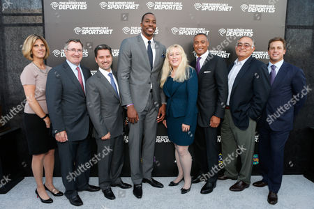 Dwight Howard, fourth from left, and Time Warner Cable executives, left to right, Irene Esteves, Glenn Britt, Rob Marcus, David Rone, Mike LaJoie and Jeff Hirsch arrive at the Time Warner Cable Sports launch event hosted by Time Warner Cable Sports, in Los Angeles