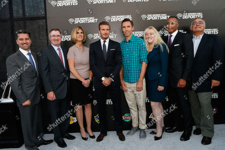 David Beckham, fourth from left, Steve Nash, fifth from left, and Time Warner Cable executives, left to right, Rob Marcus, Glenn Britt, Irene Esteves, David Rone, Melinda Witmer, Mike LaJoie and Jeff Hirsch attend the Time Warner Cable SportsNet and Time Warner Cable Deportes Networks launch event hosted by Time Warner Cable Sports, in Los Angeles