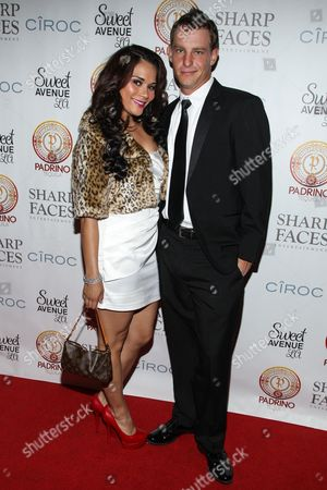 Stock Photo of Actress Alisa Reyes (L) and her fiance attend Tommy Davidson's 50th birthday celebration at H.O.M.E. on in Beverly Hills, California