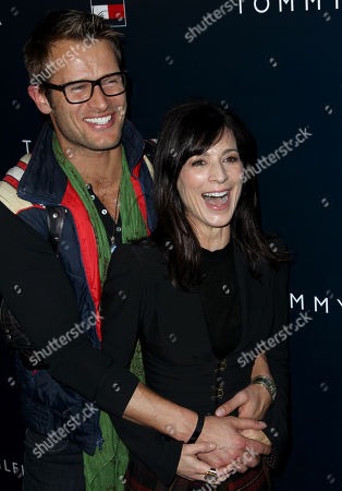 Perrey Reeves, right, and Johann Urb arrive at Tommy Hilfiger's new west coast flagship store opening in Los Angeles