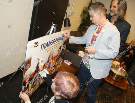 Cat Smith, left, and Ali Liebegott sign a poster at Transparent: Anatomy of an Episode at Ace Hotel, in Los Angeles