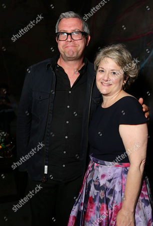 EXCLUSIVE Composer John Powell and Producer Bonnie Arnold seen at the Twentieth Century Fox and DreamWorks Animation Los Angeles Premiere of 'How to Train Your Dragon 2', in Westwood, Calif