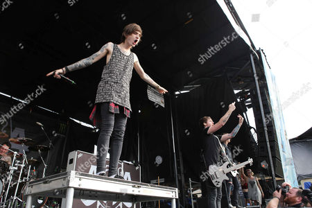 Denis Stoff with Asking Alexandria performs during the Vans Warped Tour 2015 at Aaron's Amphitheatre, in Atlanta