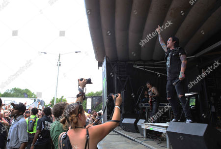Craig Mabbitt with Escape the Fate performs during the Vans Warped Tour 2015 at Aaron's Amphitheatre, in Atlanta