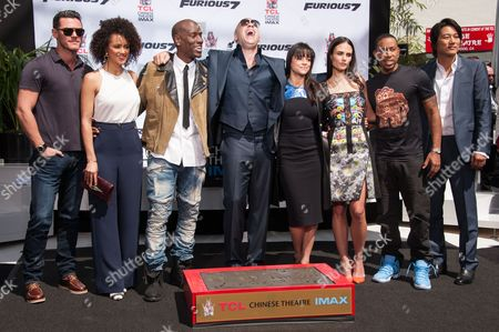 Lucas Black, from left, Nathalie Emmanuel, Tyrese Gibson, Vin Diesel, Michelle Rodriguez, Jordana Brewster, Ludacris and Tatchakorn Yeerum attend the Vin Diesel Hand And Footprint Ceremony in the courtyard of the TCL Chinese Theatre, in Los Angeles