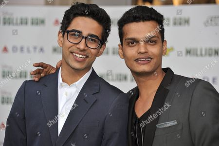 """Suraj Sharma, left, and Madhur Mittal arrive at the world premiere of """"Million Dollar Arm"""" on in Los Angeles"""