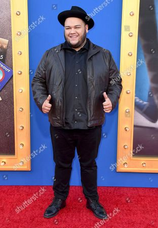"Christian Cuevas arrives at the world premiere of ""Sing"" at the Microsoft Theater, in Los Angeles"