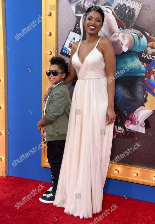 """David Daniel Otunga Jr., left, and Jennifer Hudson arrive at the world premiere of """"Sing"""" at the Microsoft Theater, in Los Angeles"""