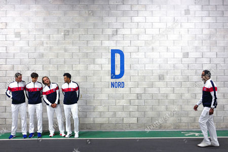 French players, from the left, Nicolas Mahut, Pierre-Hugues herbert, Lucas Pouille, Jo-Wilfried Tsonga and Captain Yannick Noah pose after the draw for the Fed Cup semi final at the Pierre Mauroy stadium in Lille, northern France, . Nine-time champion France will play in the opening singles against Serbia in the Davis Cup semifinals on Friday