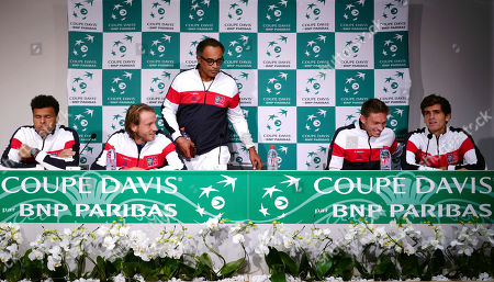 French players, from the left, Jo-Wilfried Tsonga, Lucas Pouille, Captain Yannick Noah, Nicolas Mahut and Pierre-Hugues Herbert arrive at the press conference for the Davis Cup semi final at the Pierre Mauroy stadium in Lille, northern France, . Nine-time champion France will play in the opening singles against Serbia in the Davis Cup semifinals on Friday