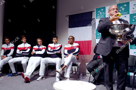 French players, from left, Nicolas Mahut, Pierre Hugues Herbert, Lucas Pouille, Jo-Wilfried Tsonga and Captain Yannick Noah attend the draw for the Davis Cup semi final at the Pierre Mauroy stadium in Lille, northern France, . Nine-time champion France will play in the opening singles against Serbia in the Davis Cup semifinals on Friday