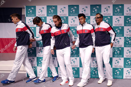 French players, from the left, Nicolas Mahut, Pierre Hugues Herbert, Lucas Pouille, Jo-Wilfried Tsonga and Captain Yannick Noah attend the draw for the Davis Cup semi final at the Pierre Mauroy stadium in Lille, northern France, . Nine-time champion France will play in the opening singles against Serbia in the Davis Cup semifinals on Friday