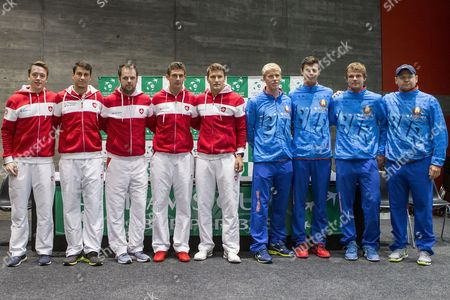 (L-R) Swiss Davis Cup Team's players Adrian Bodmer, Luca Margaroli, Swiss Davis Cup Team's captain Severin Luethi,  Swiss Davis Cup Team's players Henri Laaksonen and Marco Chiudinelli pose with Belarus Davis Cup Team's players Andrei Vasilevski, Yaraslav Shyla, Dzmitry Zhyrmont and Belarus Davis Cup Team's captain Vladimir Voltchkov during the draw ceremony for the Davis Cup world group playoffs between Switzerland and Belarus in Biel, Switzerland, 14 September 2017.