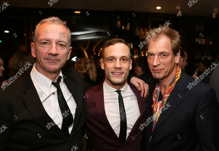 """Stock Photo of From left, """"Backbeat"""" writer Iain Softley, cast member Nick Blood (plays Stuart Sutcliffe) and actor Julian Sands pose during the party for the opening night performance of """"Backbeat"""" at the Center Theatre Group/Ahmanson Theatre on in Los Angeles, Calif"""