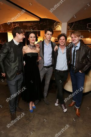"""From left, cast members Andrew Knott (plays John Lennon), Leanne Best (plays Astrid Kirchherr), Dan Westwick (plays George Harrison), Oliver Bennett (plays Pete Best) and Daniel Healy (plays Paul McCartney) pose during the party for the opening night performance of """"Backbeat"""" at the Center Theatre Group/Ahmanson Theatre on in Los Angeles, Calif"""