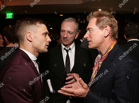 """From left, cast member Nick Blood (plays Stuart Sutcliffe), """"Backbeat"""" writer Iain Softley and actor Julian Sands talk during the party for the opening night performance of """"Backbeat"""" at the Center Theatre Group/Ahmanson Theatre on in Los Angeles, Calif"""