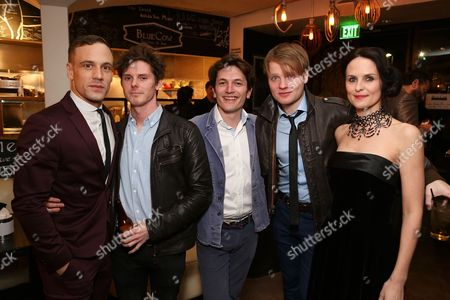 """From left, cast members Nick Blood (plays Stuart Sutcliffe), Oliver Bennett (plays Pete Best), Dominic Rouse, Daniel Healy (plays Paul McCartney) and Leanne Best (plays Astrid Kirchherr) pose during the party for the opening night performance of """"Backbeat"""" at the Center Theatre Group/Ahmanson Theatre on in Los Angeles, Calif"""