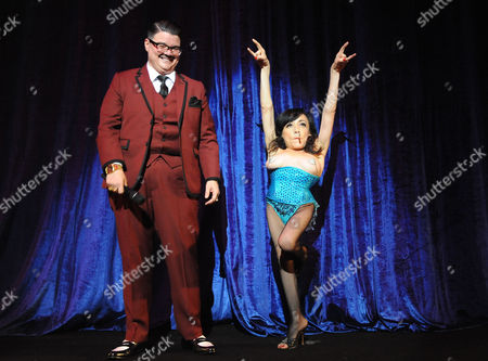 "Murray Hill, at left, and Selene Luna perform onstage at ""Burlesque: Strip Strip Hooray!"" Starring Dita Von Teese on in Los Angeles"