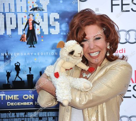 """Mallory Lewis, and Lamb Chop arrive at the """"Mary Poppins"""" 50th anniversary commemoration screening at the TCL Chinese Theatre on in Los Angeles"""
