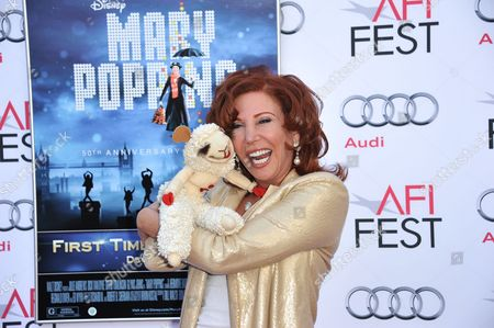 """Stock Photo of Mallory Lewis, and Lamb Chop arrive at the """"Mary Poppins"""" 50th anniversary commemoration screening at the TCL Chinese Theatre on in Los Angeles"""