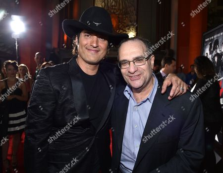 "Director Robert Rodriguez, left, and co-chairman of The Weinstein Company and Dimension Films Bob Weinstein arrive at the ""Sin City: A Dame to Kill For"" premiere presented by Dimension Films in partnership with Time Warner Cable, Dodge and DeLeon Tequila at TCL Chinese Theatre, in Los Angeles"