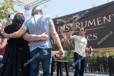 """From left, novelist Cassandra Clare, director Harald Zwart, and actor Kevin Zegers attend the """"The Mortal Instruments: City of Bones"""" meet and greet at The Americana on in Glendale, Calif"""