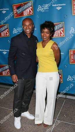 """From left, actors Kenny Lattimore and Angela Bassett pose during the arrivals for the opening night performance of """"The Scottsboro Boys"""" at the Center Theatre Group/Ahmanson Theatre, in Los Angeles, Calif"""