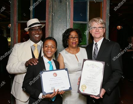 """From left, cast members Trent Armand Kendall, Deandre Sevon, City Councilwoman Jan Perry and CTG Managing Director Edward L. Rada pose during the party for the opening night performance of """"The Scottsboro Boys"""" at the Center Theatre Group/Ahmanson Theatre, in Los Angeles, Calif"""