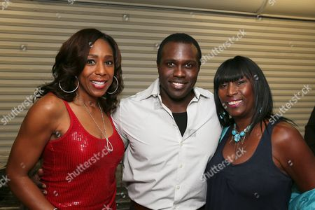 """From left, Dawnn Lewis, cast member Joshua Henry and actress Kiki Shepard pose backstage after the opening night performance of """"The Scottsboro Boys"""" at the Center Theatre Group/Ahmanson Theatre, in Los Angeles, Calif"""