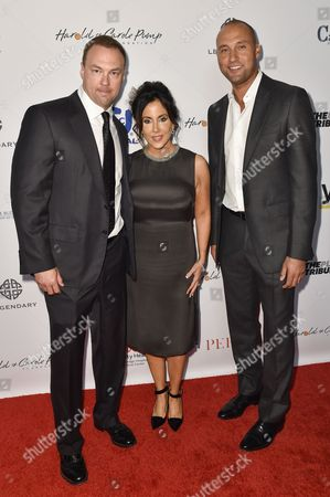 Stock Picture of Thomas Tull, from left, Alba Tull and Derek Jeter arrive at the 15th Annual Harold and Carole Pump Foundation Gala held at the Hyatt Regency Century Plaza,, in Los Angeles