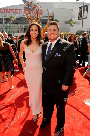 Stock Image of LOS ANGELES, CA - SEPTEMBER 10: (L-R) Jennifer Elia and Chaz Bono attends the Academy of Television Arts & Sciences 2011 Primetime Creative Arts Emmy Awards at the Nokia Theater L.A. Live on in Los Angeles, California
