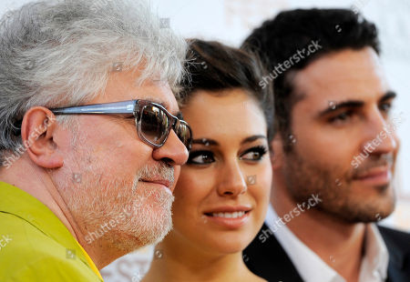 """Pedro Almodovar, left, director of """"I'm So Excited,"""" poses with cast members Blanca Suarez, center, and Miguel Silvestre at the Los Angeles Film Festival's premiere of the film at the Regal Cinemas at LA LIVE on in Los Angeles"""