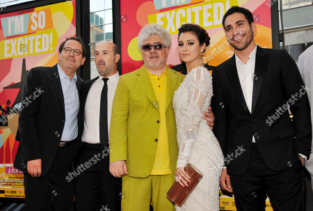 """Pedro Almodovar, center, director of """"I'm So Excited,"""" poses with, left to right, Sony Classics co-president Michael Barker and cast members Javier Camara, Blanca Suarez and Miguel Silvestre at the Los Angeles Film Festival's premiere of the film at the Regal Cinemas at LA LIVE on in Los Angeles"""