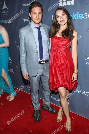 Stock Image of From left, actors Yuri Lowenthal, Tara Platt arrive at the 2013 Geekie Awards at the Avalon on in Los Angeles