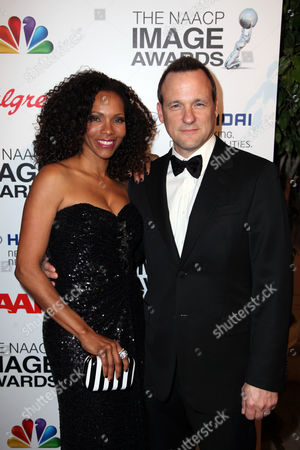 From right actor Tom Verica and guest arrive arrives during the 2013 NAACP Image Awards Hyundai After Party held at the Millennium Biltmore Hotel on in Los Angeles, Calif