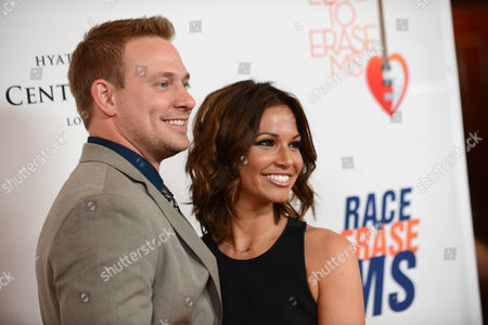 """Tye Strickland, left, and Melissa Rycroft arrive at the 20th annual Race to Erase MS event """"Love to Erase MS"""" at the Hyatt Regency Century Plaza, in Los Angeles"""