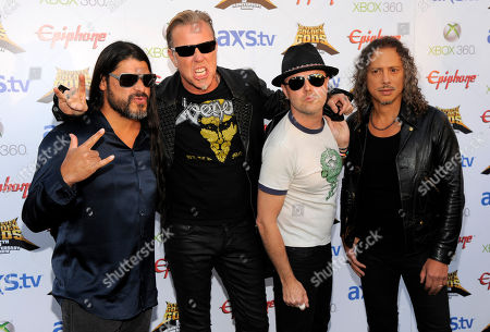 Stock Picture of Left to right, Robert Trujillo, James Hetfield, Lars Ulrich and Kirk Hammett of Metallica, recipients of the Ronnie James Dio Lifetime Achievement Award, pose together at the 2013 Revolver Golden Gods Award Show at Club Nokia on in Los Angeles