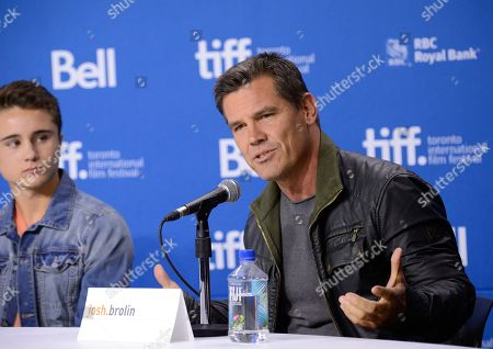"Actor Josh Brolin, right, and Gattlin Griffith participate in the press conference for ""Labor Day"" on day 3 of the 2013 Toronto International Film Festival at the TIFF Bell Lightbox on in Toronto"