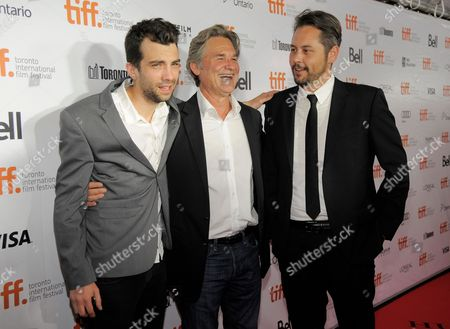 """Stock Image of From left, actors Jay Baruchel, Kurt Russell and director Jonathan Sobol arrive at the premiere of """"The Art of the Steal"""" on day 7 of the Toronto International Film Festival at Roy Thomson Hall on in Toronto"""