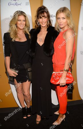 Models Rachel Hunter, left, Carol Alt and Daniela Pestova attend the 2014 Sports Illustrated Swimsuit 50th Anniversary Issue kickoff event at Swimsuit Beach House, in New York