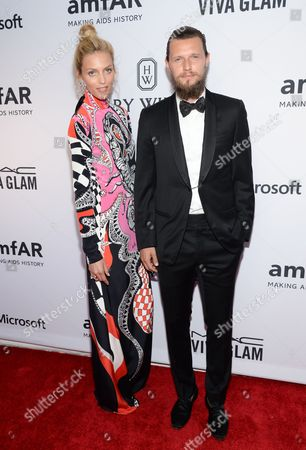 Stock Picture of Anja Rubik and Sasha Knezevic attend the 6th Annual amfAR New York Inspiration Gala at Spring Studios, in New York